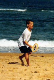 William Mancini playing on the beach