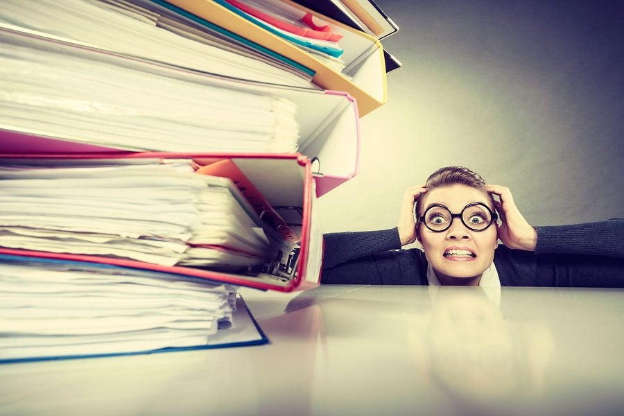 bigstock-Accountant-Terrified-Of-Pils-O-131043989.jpg