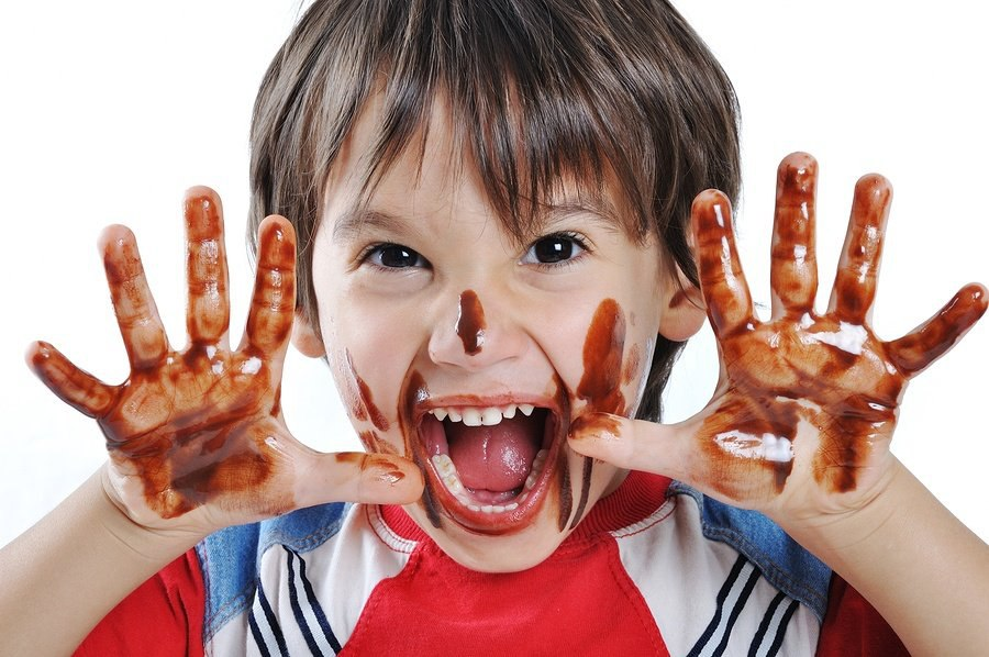 bigstock-Chocolate-on-hands-and-face-f-15439517.jpg