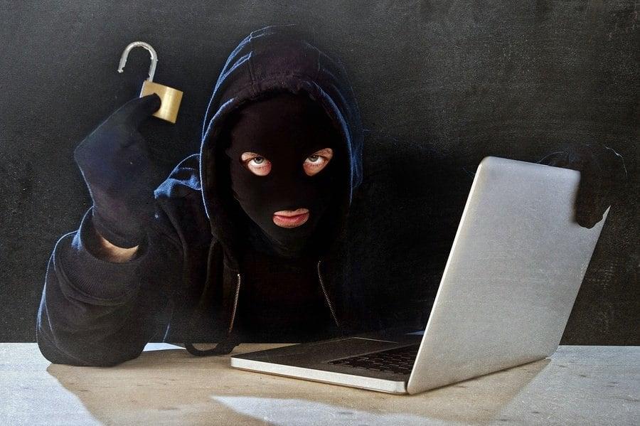 bigstock-Dangerous-Hacker-Man-With-Comp-88982630.jpg