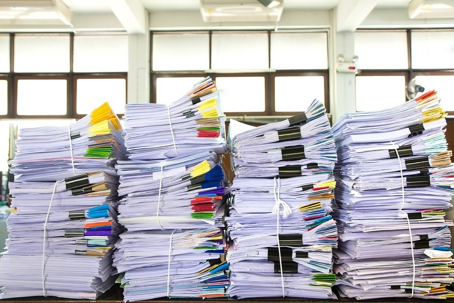 bigstock-Stack-Of-Business-Papers-88335854