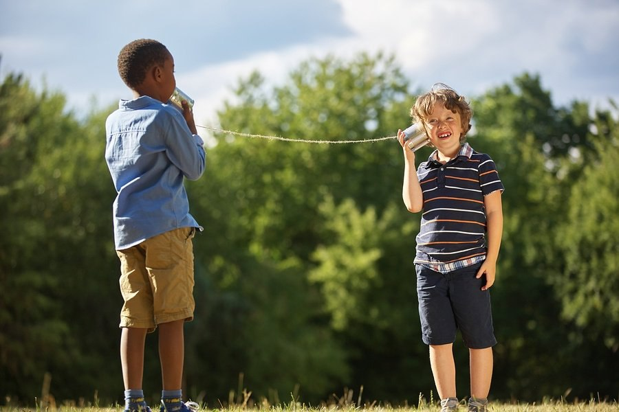 bigstock-Two-boys-play-with-tin-can-tel-143581307.jpg